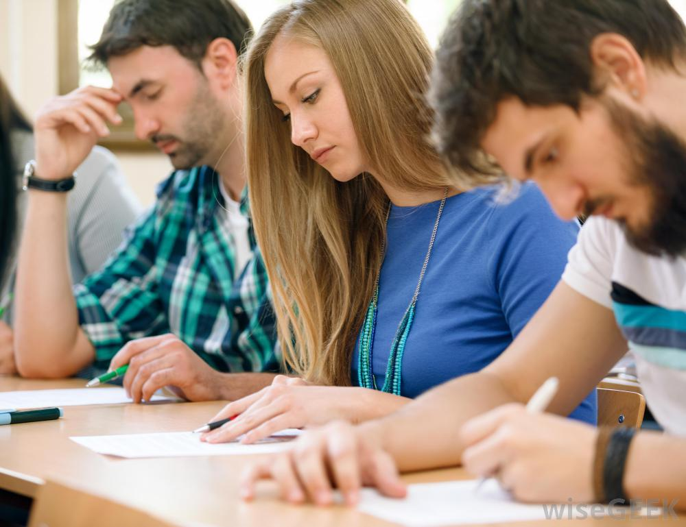 older-students-at-long-desk-taking-a-test.jpg